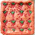Uncut pan of pink Strawberry Brownies with Strawberry Press Cookies baked on top