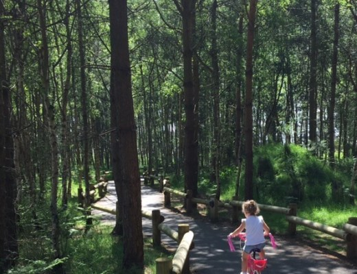 little girls cycling through Woburn Forest Center Parcs