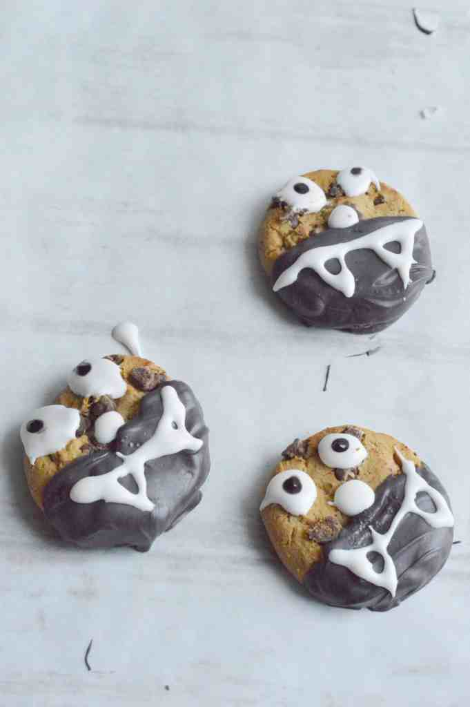 Halloween fang cookies chocolate chip cookies dipped in chocolate with fang icing