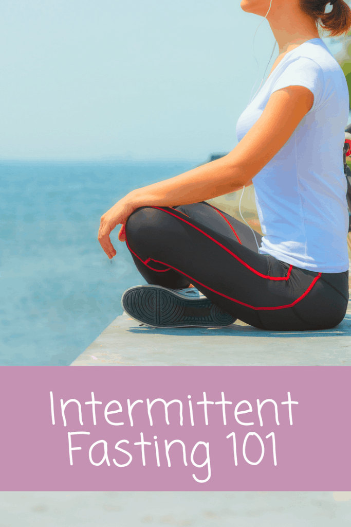 Intermittent Fasting for weight loss: woman sitting near the ocean fasting and thinking