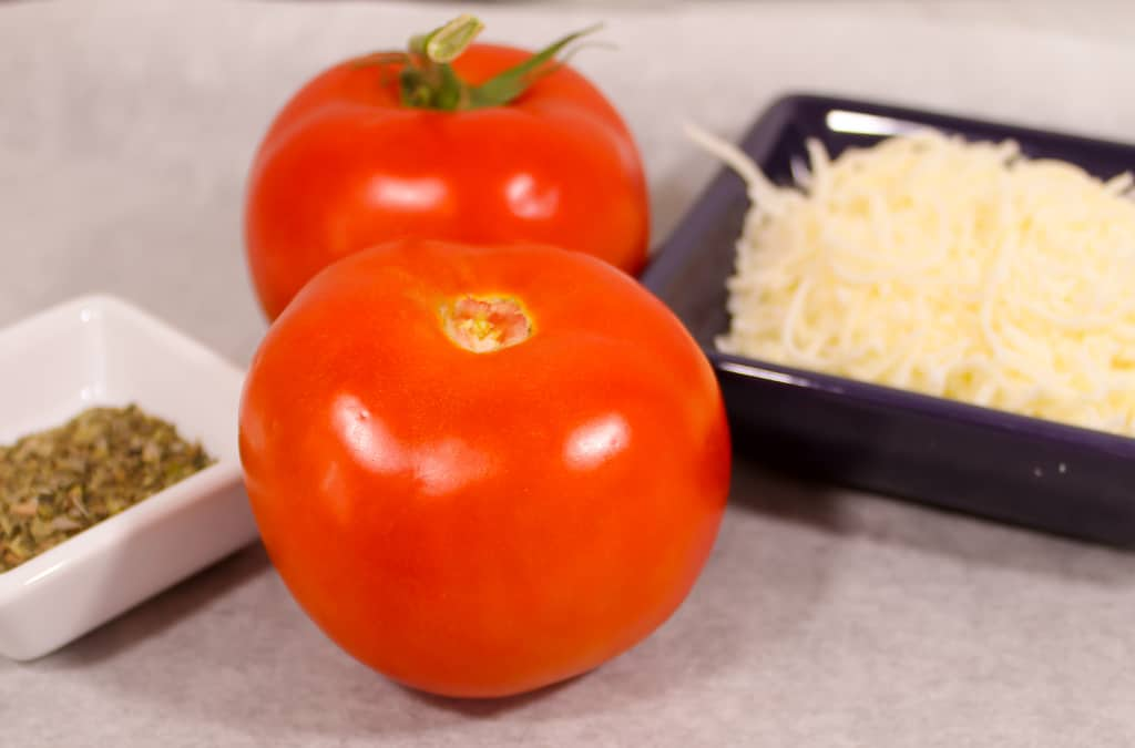 Tomatoes, Pizza Seasoning, and Mozzarella cheese are the ingredients for Keto Friendly Italian Tomato Pizza Bites