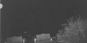 Ghost Orbs Over Cemetery