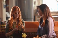 "SHADOWHUNTERS - ""The Mortal Cup"" - One young woman realizes how dark the city can really be when she learns the truth about her past in the series premiere of ""Shadowhunters"" on Tuesday, January 12th at 9:00 - 10:00 PM ET/PT. ABC Family is becoming Freeform in January 2016. Based on the bestselling young adult fantasy book series The Mortal Instruments by Cassandra Clare, ""Shadowhunters"" follows Clary Fray, who finds out on her birthday that she is not who she thinks she is but rather comes from a long line of Shadowhunters - human-angel hybrids who hunt down demons. Now thrown into the world of demon hunting after her mother is kidnapped, Clary must rely on the mysterious Jace and his fellow Shadowhunters Isabelle and Alec to navigate this new dark world. With her best friend Simon in tow, Clary must now live among faeries, warlocks, vampires and werewolves to find answers that could help her find her mother. Nothing is as it seems, including her close family friend Luke who knows more than he is letting on, as well as the enigmatic warlock Magnus Bane who could hold the key to unlocking Clary's past. (ABC Family/John Medland) KATHERINE MCNAMARA, MAXIM ROY"