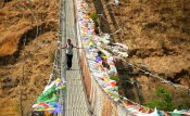 Locals commuting on the Punakha suspension bridge on Po Chu river. Photo: Kaushik Naik