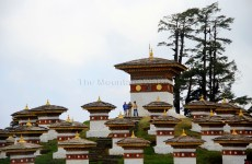 """Mingling with the atmosphere (and colours) amidst the """"Chortens"""" at Dochula Pass ; Photo: Kaushik Naik"""