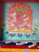 Buddhist panel-art at the Gate to Kamru village.
