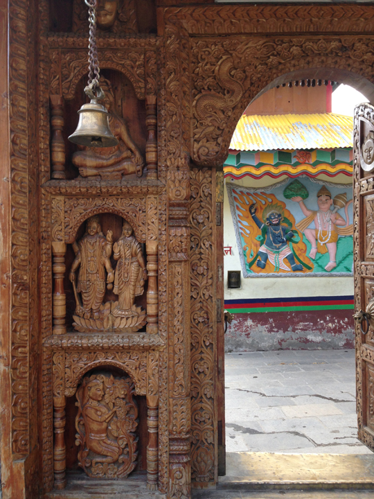 Intricate carvings on the wooden entrance gate to the Temple complex. Photo: sanjay mukherjee