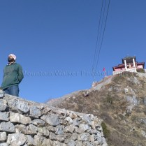 Sanjay soaks in the sun (and lots of energy) at Shaali Tibba (Peak) after a taxing climb