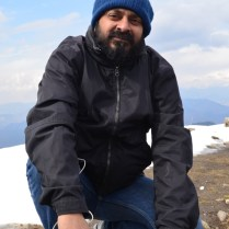 Sanjay ends the Skype call and quietly sits down to give Abhishek a free field to capture a panorama atop Hatu Peak