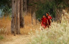 Young monks enjoy a run along the road next to the river at Punakha Dzong; Photo: Kaushik Naik