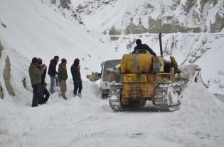 The Bulldozer upon reaching the car, giving it a nudge to push it through; Photo: Abhinav Kaushal