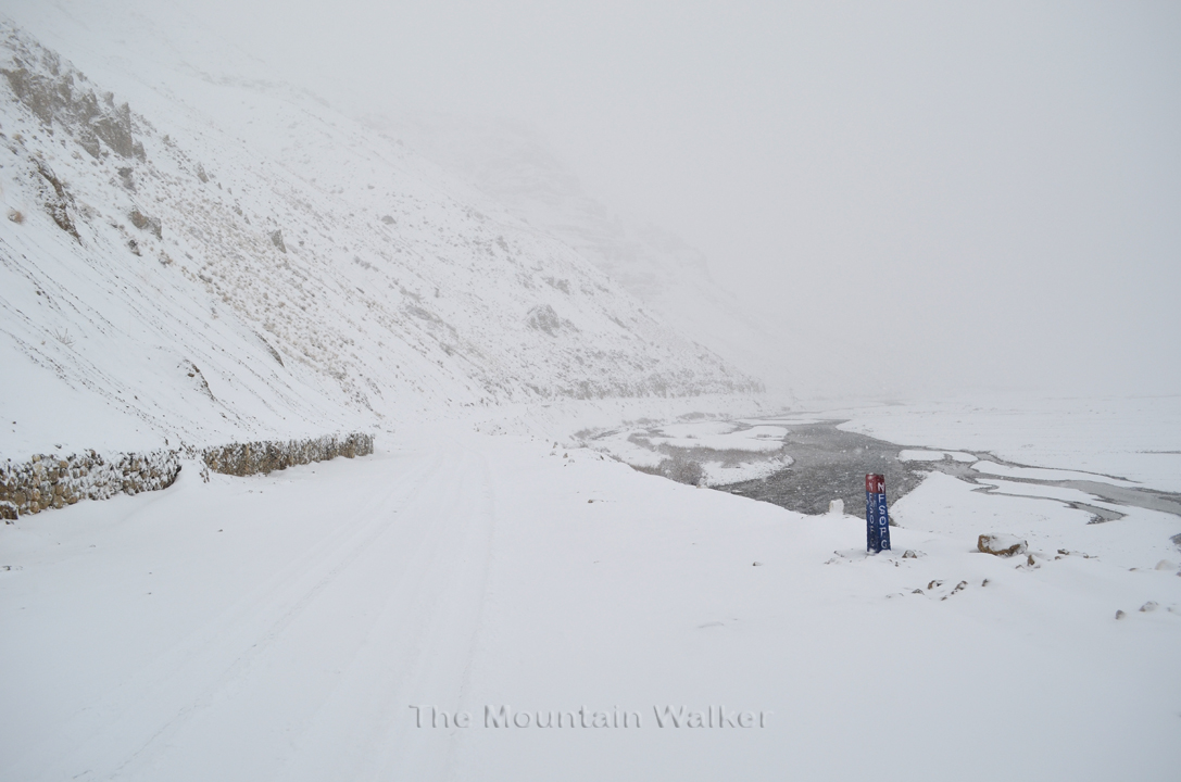The snow covered road with river Spiti adjacent to it.