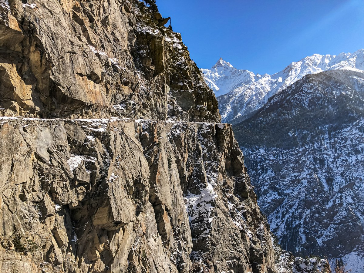 'Kalpa Roghi Suicide Point' by Sanjay Mukherjee provides a distant view of the Suicide Point on the Kalpa-Roghi road across the sacred Kinner Kailash range.