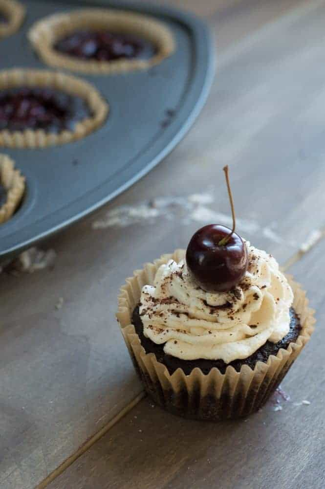 Black Forest Cupcakes that are homemade and stuffed with a cherry filling