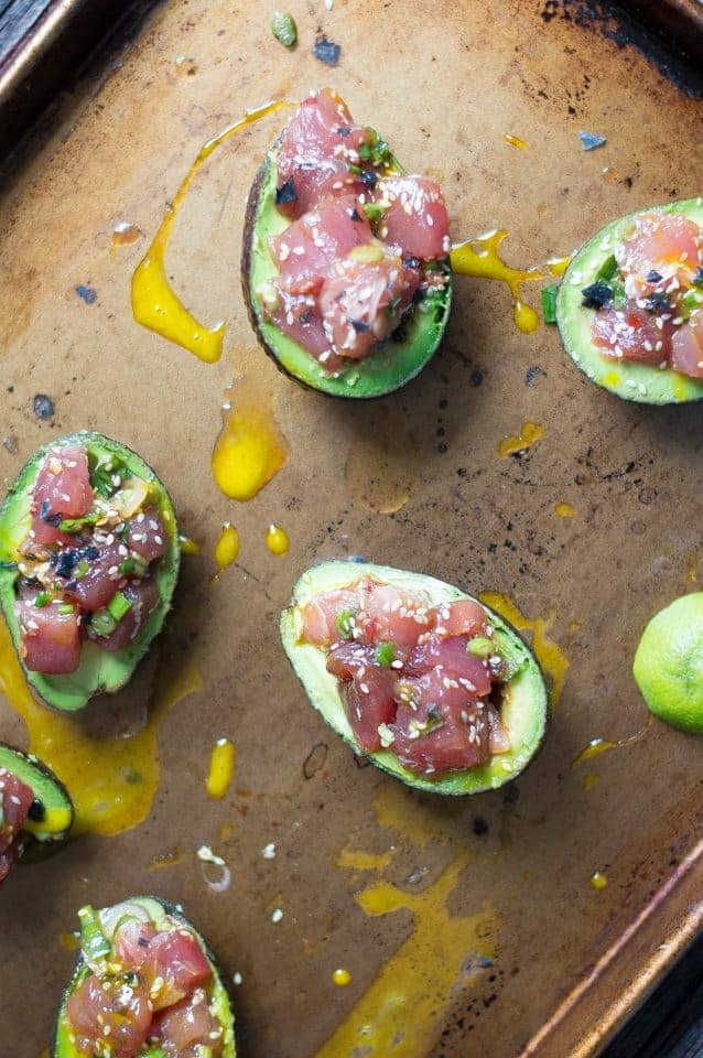 Ahi Poke Avocado Boats. How cute are these ?? They are super easy to make and even more delicious to eat. Poke at home! TheMovementMenu.com