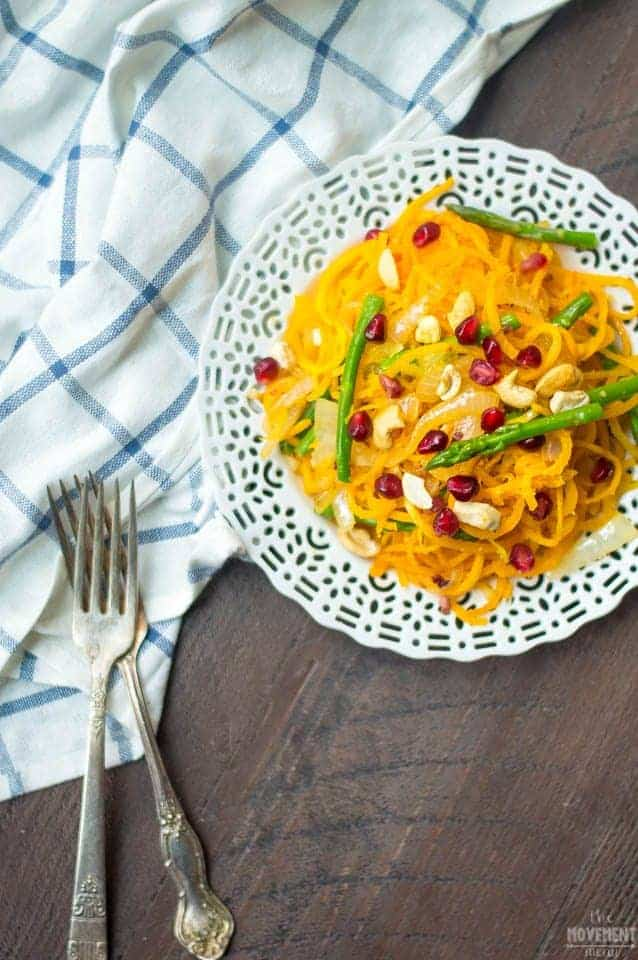 Spiralized Butternut Squash Noodles with Asparagus, Cashews & Pomegranate... this recipe is gluten free and super healthy and nutrient dense. It is vegetarian, paleo and vegan friendly! TheMovementMenu.com