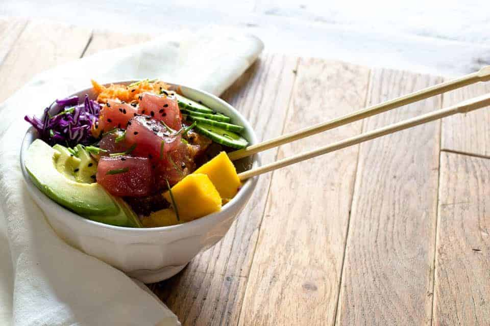 This Hawaiian Poke Bowls recipe is the ultimate one bowl feast! You can top yours off with toppings of your choice. Healthy, gluten free & delicious.