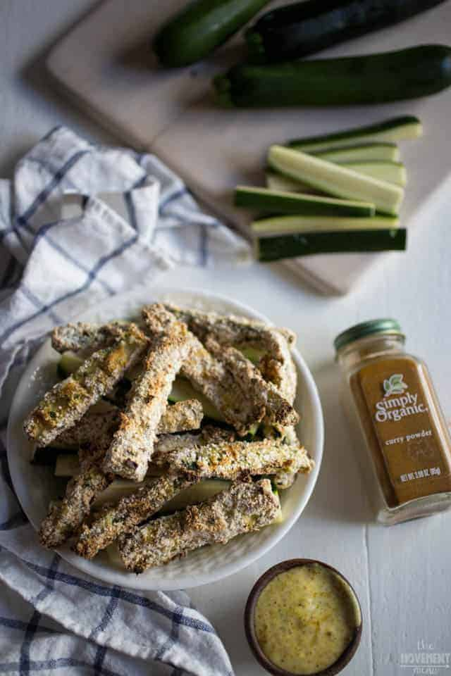 These zucchini fries with curry aioli could be the best snack food ever. They're free of gluten, grains and taste dang delicious with this dipping sauce. A healthy alternative that tastes INCREDIBLE right here. TheMovementMenu.com