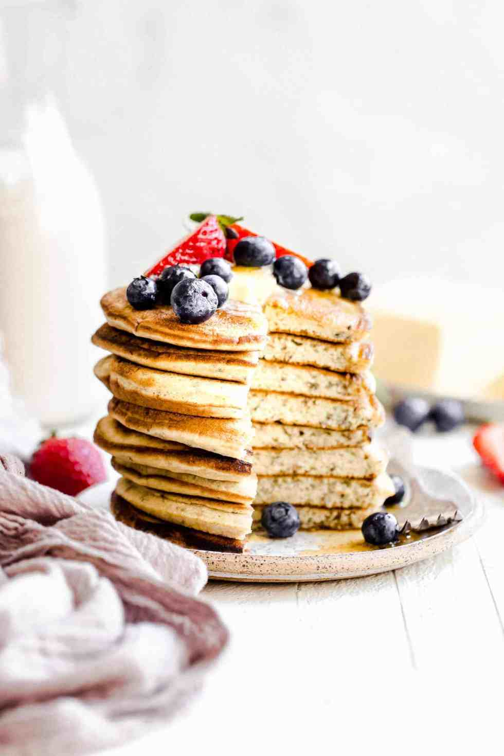 stack of paleo pancakes with berries on top