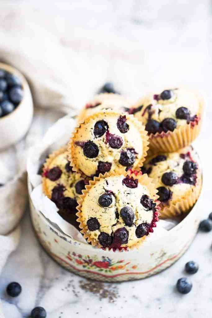 gluten free vegan blueberry muffins stacked in a box