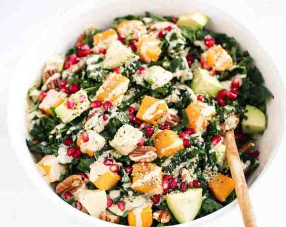 Roasted Butternut Salad with kale, avocado, pecans & pomegranate. A healthy, gluten free recipe filled with fall flavors. Easy, filling and perfect for make ahead lunches and dinners! Recipe at themovementmenu.com