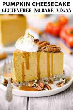 a slice of pumpkin cheesecake on a white place with caramel sauce and whipped cream