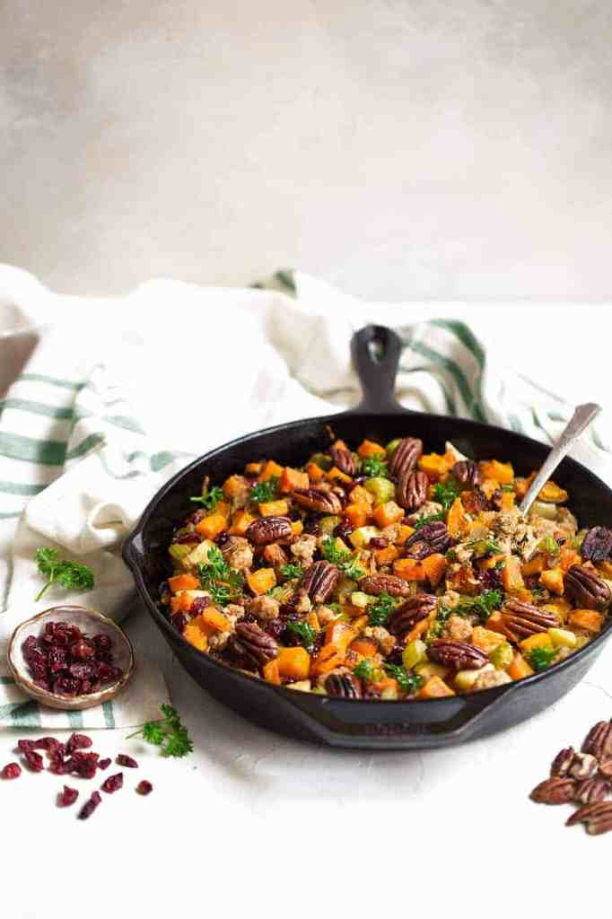 Gluten Free Stuffing recipe that is full of nutrient dense vegetables and topped off with toasted pecans and dried cranberries. It can be made vegan as well if you omit the sausage. Gluten free stuffing recipe. Grain free stuffing recipe. Paleo thanksgiving recipes.