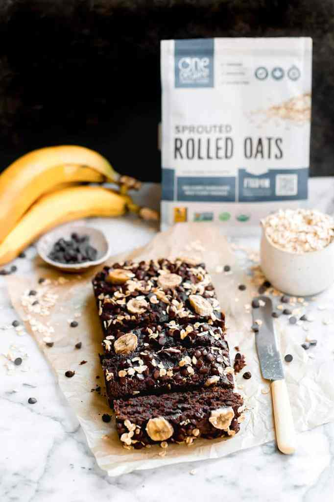 This easy vegan chocolate banana bread is super decadent and moist with just the right amount of sweetness. It is fluffy inside and can be made in one bowl… such delicious vegan banana bread! #vegan #bananabread #glutenfree #chocolate