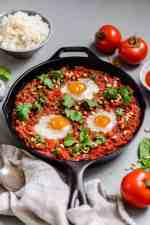 A paleo and Whole30 easy shakshuka recipe that's perfect for breakfast, lunch or dinner. This shakshuka recipe is served over a bed of cauliflower rice and is grain free, dairy free and absolutely delicious! #whole30 #whole30recipes #paleo #shakshuka
