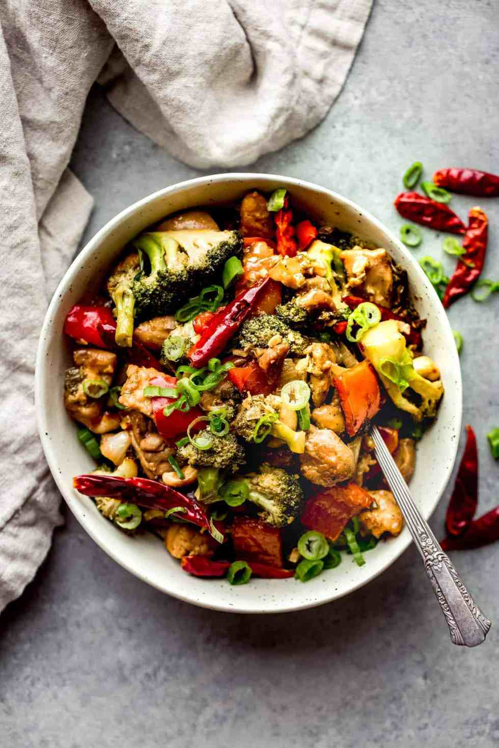 cashew chicken with broccoli in a bowl