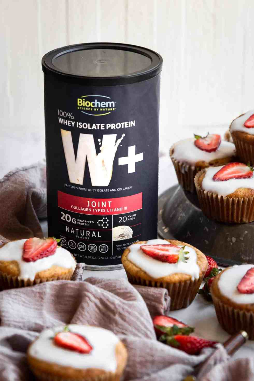 grass fed whey protein canister amongst muffins
