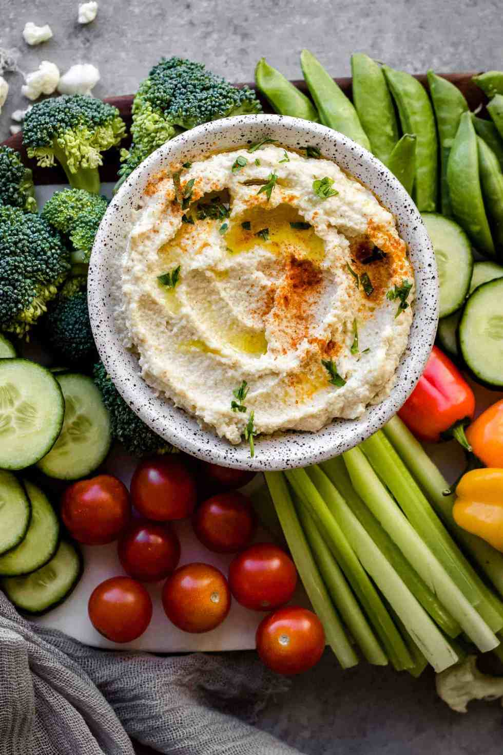 close up shot of cauilflower hummus and vegetables