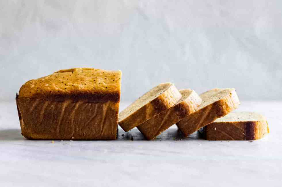side shot of lemon poppy seed bread cut into slices