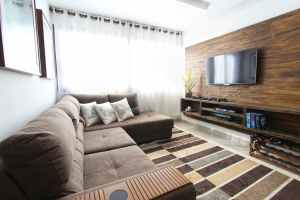 An interior of an apartment will be more spacious after moving from Brooklyn to California.