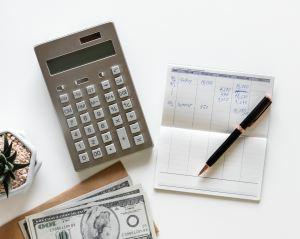 Cash, bills and a calculator