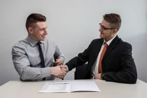 businessmen shaking hands over a contract