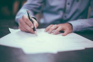 Person signing a moving contract