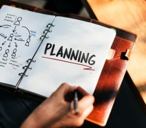 """Planner opened on a page where """"PLANNING"""" is writtened and underlined"""