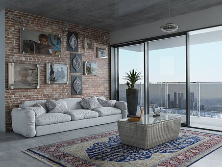 a room in an apartment with modern furniture and big windows