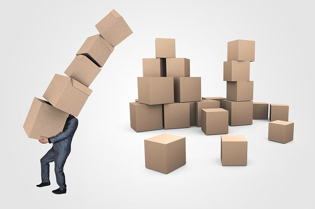 A person carrying a lot of boxes.