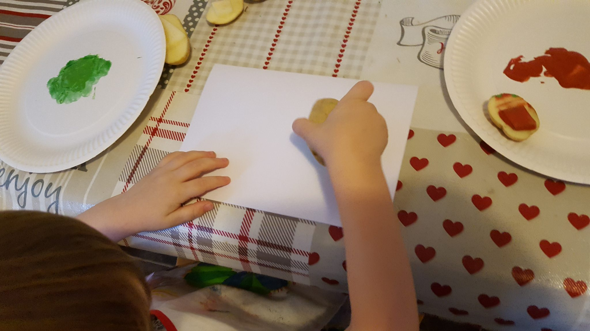 The boys all really loved to make the cards. All you need is 2 potatoes cut into shapes.