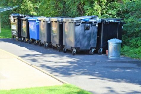 The bins behind the facilities block at Cambridge Camping and Caravanning Club