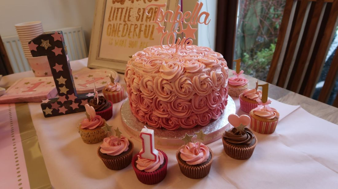 Twinkle Twinkle Little Star themed birthday party with swirl icing cake and cupcakes in pink
