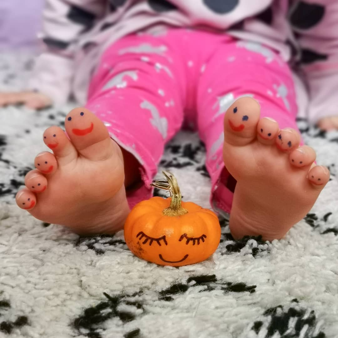 Toddler activities - drawing smiley faces on toes