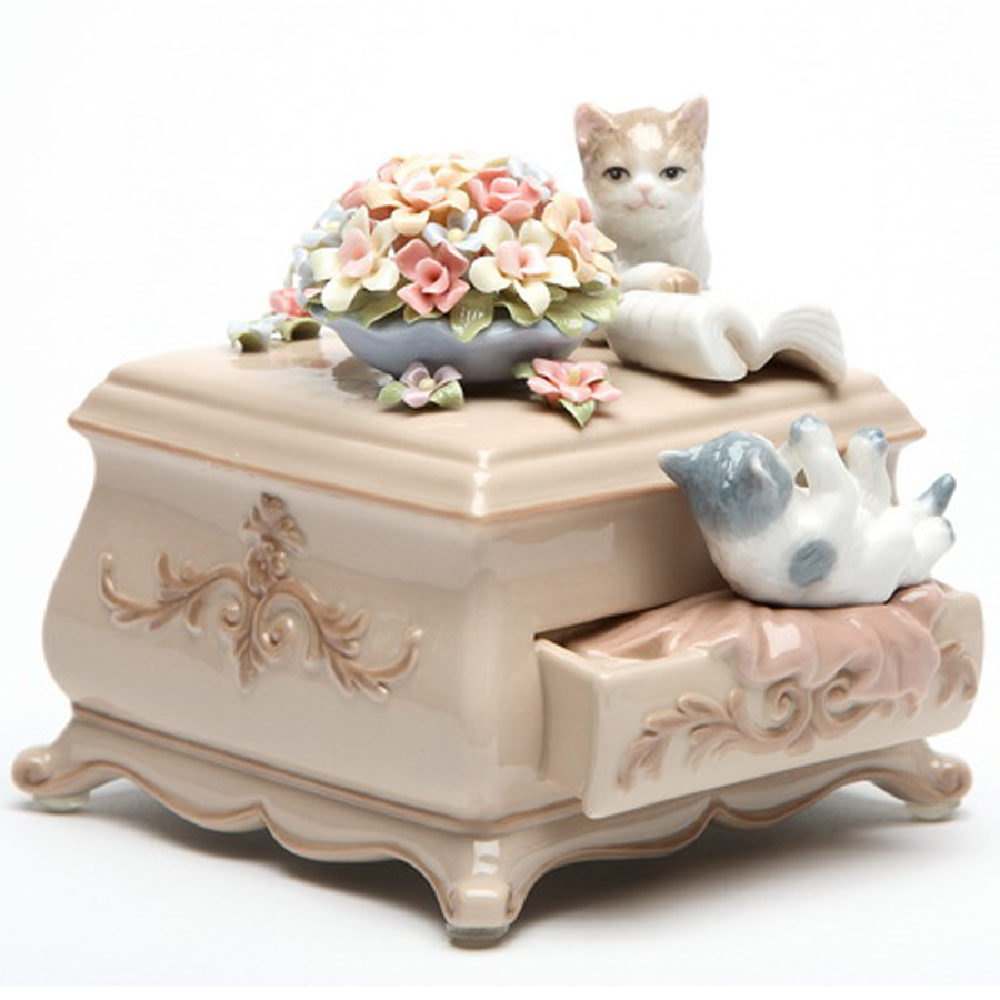 Porcelain musical Cats on dresser with flowers