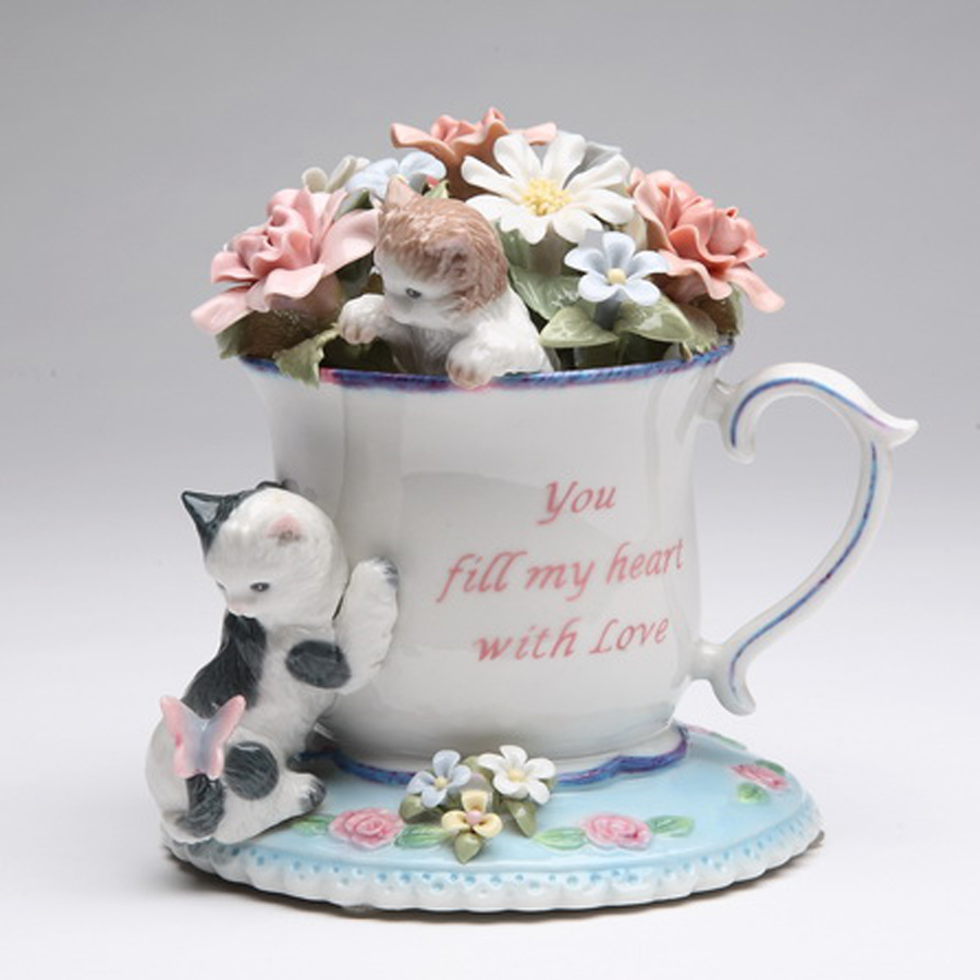 Porcelain musical kittens with tea cup and flowers