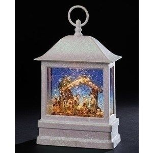 Large white lantern with lighted full nativity scene inside