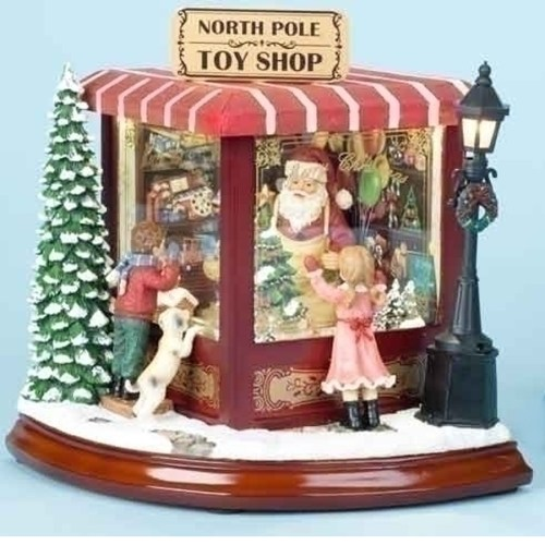 North Pole Toy Shop with Santa inside and childrennlooking into the window musical