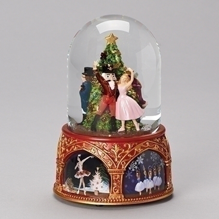 Nutcracker musical globe with rotating figures inside and Russian art on the base