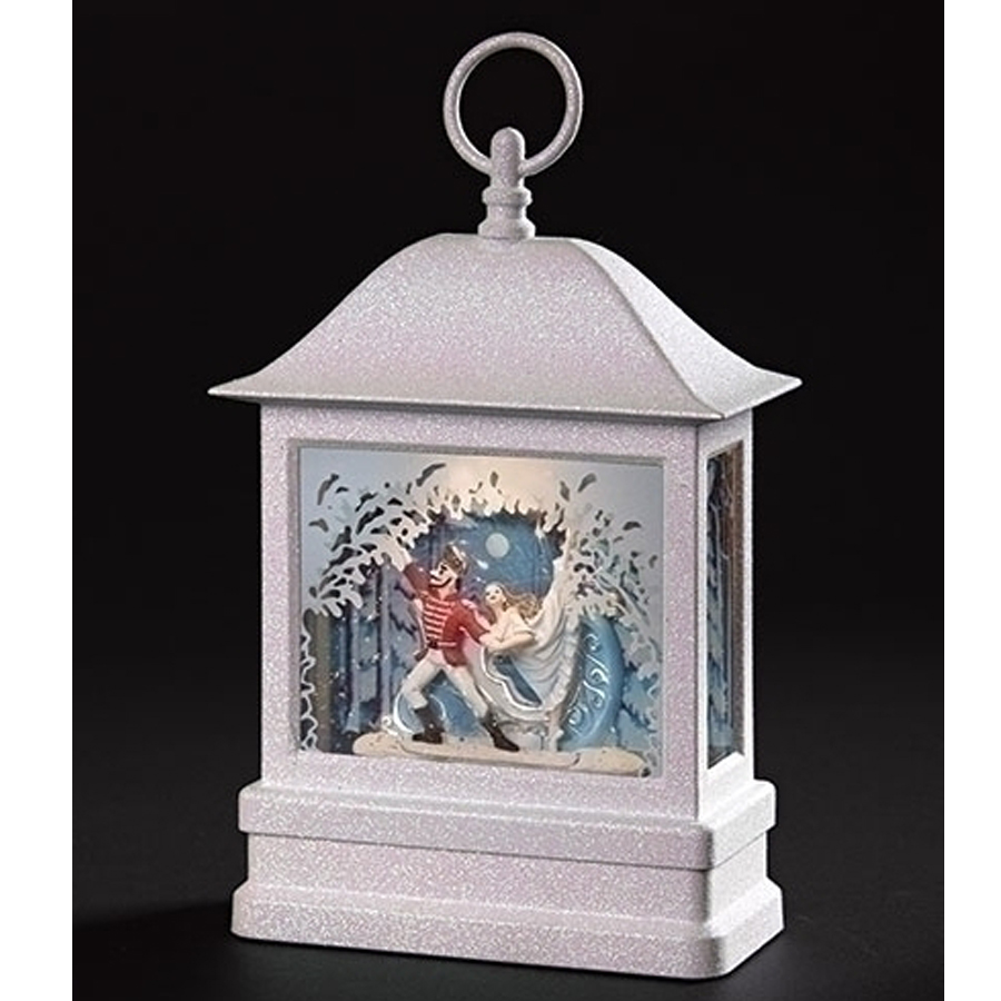 Large white lantern with lighted nutcracker scene inside